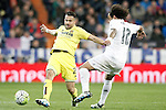 Real Madrid's Marcelo Vieira (r) and Villareal's Mario Gaspar during La Liga match. April 20,2016. (ALTERPHOTOS/Acero)