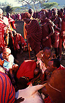 Maasai queue up to drink the blood from a sacrificial bull  during the intiation ceremony of the maasai Moran into manhood. Kajiado, Kenya.