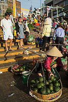 One of the specialities of Dalat market  avocados as well as other locally grown produce.  Strawberries and artichokes other local specialities of the region. Dalat Market was originally commissioned by the French ambassador to Vietnam in 1929 and was  located at the site where the Hoa Binh Theatre is today. The original Dalat Market was made of pine, which is why people called it Wood Market. Dalat Market was moved under the theatre when it was rebuilt in concrete in the 1950s and now sprawls into surrounding streets and alleys.