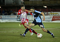 Luke O'Nien of Wycombe Wanderers hand in Seamus Conneely of Accrington Stanley mouth<br /> <br /> during the Sky Bet League 2 match between Accrington Stanley and Wycombe Wanderers at the Wham Stadium, Accrington, England on 16 March 2016. Photo by Tony (KIPAX) Greenwood / PRiME Media Images.