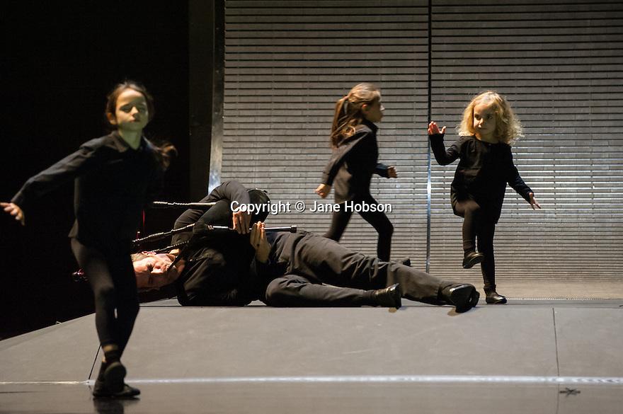 London, UK. 28.01.2014. Boris Charmatz/ Musee de la Danse presents ENFANT, in its UK premiere at Sadler's Wells. Photograph shows: Erwan Keravec (Bagpipes) and the ensemble. Photograph © Jane Hobson.
