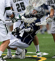 Travis Comeau (44) of Georgetown is surrounded by a bevy of Loyola defenders at the Ridley Athletic Complex in Baltimore, MD.  Loyola defeated Georgetown, 11-6.
