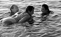 HINESBURG, VT - 20 AUGUST 2008 -112008JT35-.Marie Tyrrell and her niece Nashira Baril and daughter Tracie Marcil laugh as they swim in Lake Iroquois in Hinesburg, Vt. on Aug. 20, 2008. This was the first time since being diagnosed with stage four lung cancer that Marie was able to swim in the lake without being short of breath or too weak to swim. This was also the first summer since being diagnosed that Marie was not undergoing chemo treatments. .Josalee Thrift / Republican-American