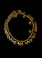 Bronze Age Hattian gold necklace from Grave TM, possibly a Bronze Age Royal grave (2500 BC to 2250 BC) - Alacahoyuk - Museum of Anatolian Civilisations, Ankara, Turkey. Against a black background