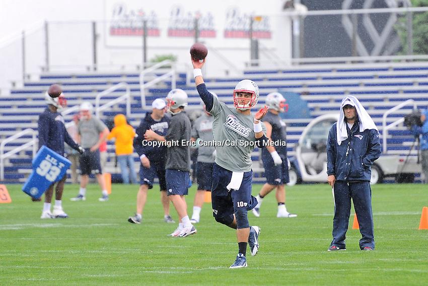 June 5, 2014 - Foxborough, Massachusetts, U.S. -  New England Patriots quarterback Jimmy Garoppolo (10) throws a pass at the team's organized team activity at Gillette Stadium in Foxborough, Massachusetts. Eric Canha/CSM