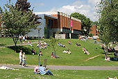 Students relax on a sunny afternoon following end-of-year exams at Sussex University