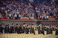 NWA Democrat-Gazette/BEN GOFF @NWABENGOFF<br /> Graduates proceed into the arena Saturday, May 20, 2017, during commencement for the Bentonville High School class of 2017 in Bud Walton Arena in Fayetteville.