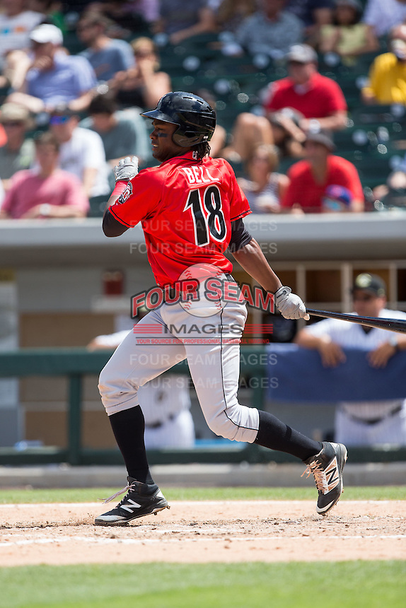 Josh Bell (18) of the Indianapolis Indians follows through on his swing against the Charlotte Knights at BB&T BallPark on June 19, 2016 in Charlotte, North Carolina.  The Indians defeated the Knights 6-3.  (Brian Westerholt/Four Seam Images)