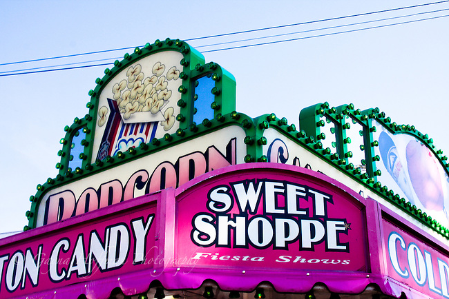 Sweet Shoppe, popcorn, sign with lights at carnival.