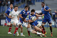 Rugby, torneo Sei Nazioni 2013: Italia vs Francia. Roma, stadio Olimpico, 3 febbraio 2013..France's Yoann Huget is tackled by Italy's Tommaso Benvenuti during the Six Nations rugby union international match between Italy and France, at Rome's Olympic stadium, 3 February 2013..UPDATE IMAGES PRESS/Riccardo De Luca