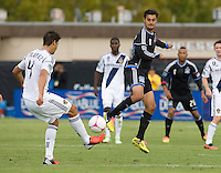Chris Wondolowski of Earthquakes tries to block Galaxy's Omar Gonzalez's shot during the game at Buck Shaw Stadium in Santa Clara, California on October 21st, 2012.  San Jose Earthquakes and Los Angeles Galaxy tied at 2-2.