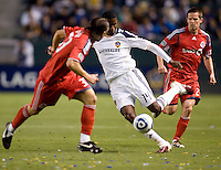 LA Galaxy forward Edson Buddle (14) moves around Toronto FC defender Maksim Usanov (33). The LA Galaxy and Toronto FC played to a 0-0 draw at Home Depot Center stadium in Carson, California on Saturday May 15, 2010.  .