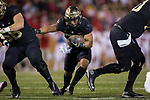 Matt Colburn II (22) of the Wake Forest Demon Deacons runs through a hole created by his offensive line during first half action against the North Carolina State Wolfpack at BB&T Field on November 18, 2017 in Winston-Salem, North Carolina.  (Brian Westerholt/Sports On Film)