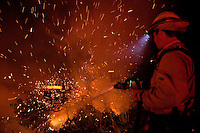 Santa Barbara, Calif., May 6, 2009 - With winds raging up to 50 mph, crews from Santa Barbara County Fire Department battle the Jesusita Fire on Gibraltar Road above Santa Barbara. The blaze destroyed several homes in the area as well as knocking out the 220-kilovolt Goleta transmission line which are the primary source for Santa Barbara County.  Governor Arnold Schwarzenegger has declared a state of emergency. During a 10 am press conference the Governor added that 5,400 homes (13,575 people) have been evacuated, 3,500 homes are considered threatened and several dozen have been lost, though no official number has been released.