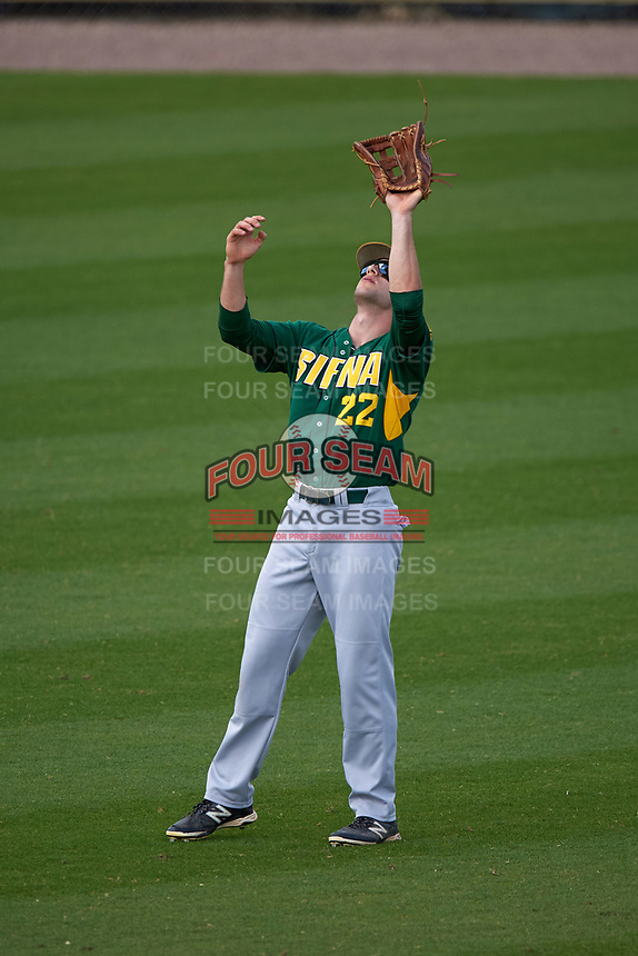 Siena Saints center fielder Dan Swain (22) catches a fly ball during a game against the UCF Knights on February 21, 2016 at Jay Bergman Field in Orlando, Florida.  UCF defeated Siena 11-2.  (Mike Janes/Four Seam Images)