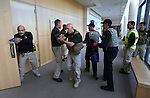 Multiple agencies from the Carson City area train in an armed assailant drill at the Carson City Courthouse in Carson City, Nev., on Saturday, Nov. 15, 2014.<br /> Photo by Cathleen Allison