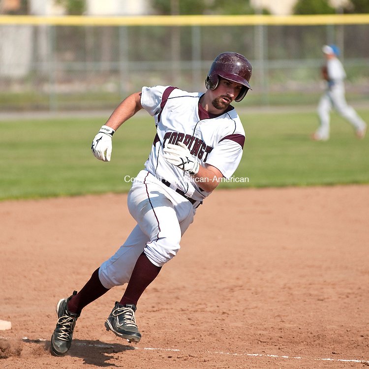TORRINGTON, CT, 31 MAY 2011-053111JS12--Torrington's Garrett Perusse (8) rounds third on his way home to score on a double by Dustyn Marfyak during their Class L state tournament game against Tolland Tuesday at Fuessenich Park in Torrington.  Torrington lost to Tolland 7-4.<br /> Jim Shannon/Republican-American