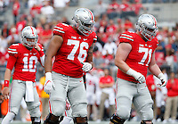 Ohio State Buckeyes offensive linemen Branden Bowen (76) and Kyle Trout (71) line up in front of quarterback Joe Burrow (10) during the NCAA football game against the Rutgers Scarlet Knights at Ohio Stadium in Columbus on Oct. 1, 2016. Ohio State won 58-0. (Adam Cairns / The Columbus Dispatch)