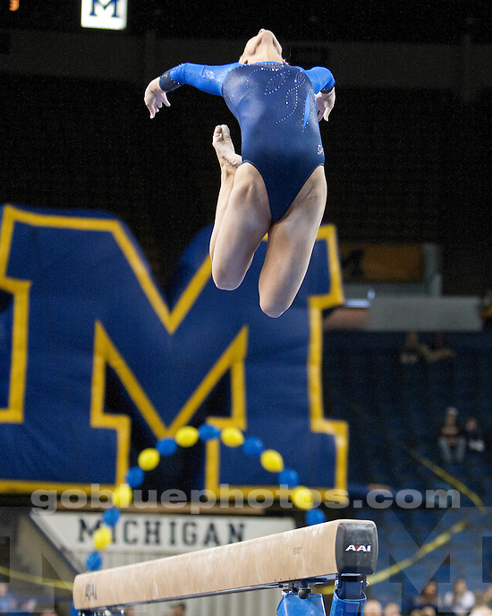 The #8 University of Michigan women's gymnastics team places 2nd of 3 (196.500 points) vs. #9 Nebraska (195.400) and #2 Stanford (196.800) at Crisler Arena in Ann Arbor, MI, on February 13, 2011.