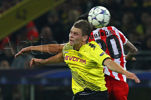 01.10.2011 Dortmund Germany.  Dortmund's Lukasz Piszczek (L) and Olympiacos' Jose Holebas vie for the ball during the UEFA Champions League group F soccer match between Borussia Dortmund and Olympiacos Piraeus at the Signal-Iduna-Park stadium in Dortmund, Germany. Mandatory credit: ActionPlus