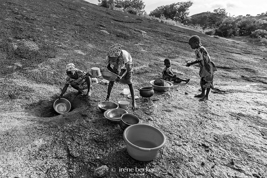 Fulani girls  doing the washing up. Kajuru, North-western Nigeria.