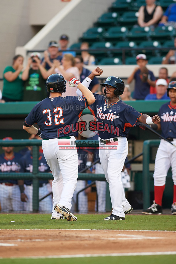 Daytona Tortugas Shed Long (right) celebrates with teammate Gavin LaValley (32) after hitting a home run in the bottom of the third inning during the Florida State League All-Star Game on June 17, 2017 at Joker Marchant Stadium in Lakeland, Florida.  FSL North All-Stars  defeated the FSL South All-Stars  5-2.  (Mike Janes/Four Seam Images)