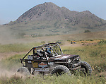 Lance Horst works his way around the course at the beginning of the Buffalo Chip 100 off-road racing event Saturday at the T.O.R.C. track in Sturgis, S.D. Bear Butte served as a backdrop for the event. (Photo by Richard Carlson/Inertia)