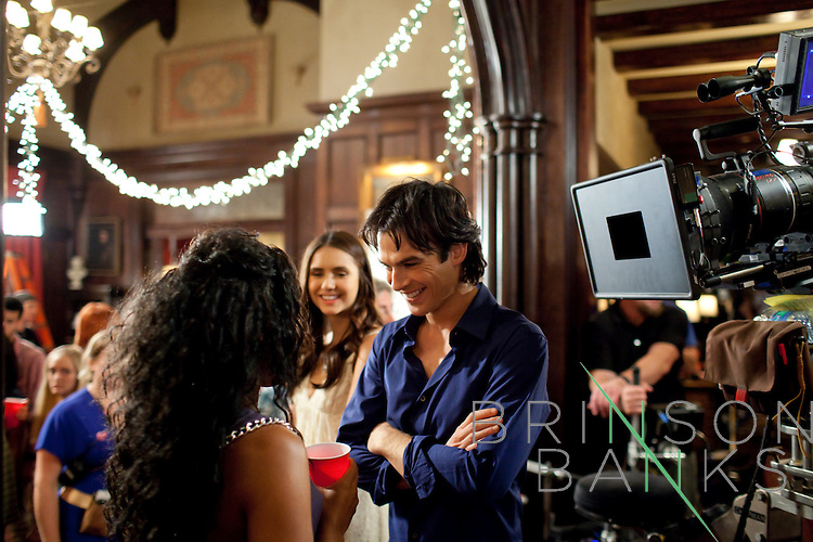 Actors Ian Somerhalder  (right) and Nina Dobrev (center) on the set of the season three premiere of The Vampire Diaries in Decatur, Georgia July 18, 2011.