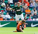 Dundee Utd's John Rankin goe in late on Hib's Scott Robertson.