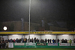 Belper Town v Gresley, 28/01/2014. Christchurch meadow, Northern Premier League. Spectators sheltering from the rain in the Reg Walker stand during the first-half of Belper Town's match against Gresley, in a Northern Premier League, first division south fixture at Christchurch meadow. The home side have played at their current ground since the club was reformed in 1951. Belper won this fixture against their local Derbyshire rivals by 4 goals to 1 watched by a crowd of 165 spectators. Photo by Colin McPherson.