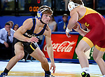 BROOKINGS, SD - NOVEMBER 4:  Ben Gillette from South Dakota State battles with Kyle Larson from Iowa State in their 125 pound match Friday evening at Frost Arena in Brookings. (Photo by Dave Eggen/Inertia)