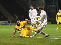 Michael Higdon lunges in to foul Mark Reynolds in the Motherwell v Aberdeen, Clydesdale Bank Scottish Premier League match at Fir Park, Motherwell on 26.12.12.