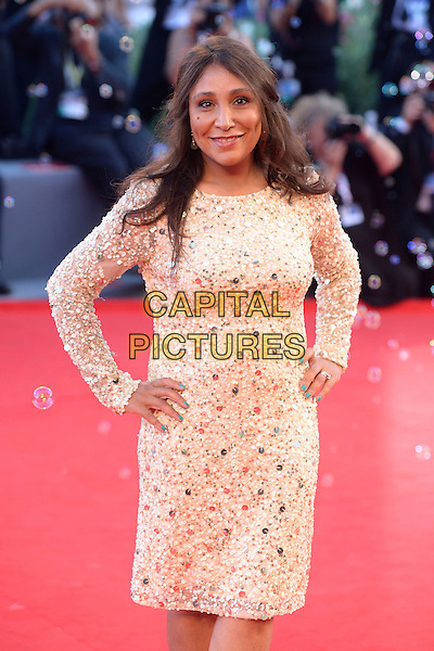 Haifaa al-Mansour<br /> attending the Closing Ceremony of the 70th Venice International Film Festival at Palazzo del Cinema in Venice, Italy, September 7th 2013.<br /> half length hands on hips cream long sleeve dress  gold sequined sequin <br /> CAP/ZZG<br /> &copy;ZZG/Capital Pictures