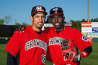 Luke Tendler (18) and Michael De Leon (1) of the Hickory Crawdads pose for a photo prior to the game against the Kannapolis Intimidators at L.P. Frans Stadium on April 23, 2015 in Hickory, North Carolina.  The Crawdads defeated the Intimidators 3-2 in 10 innings.  (Brian Westerholt/Four Seam Images)