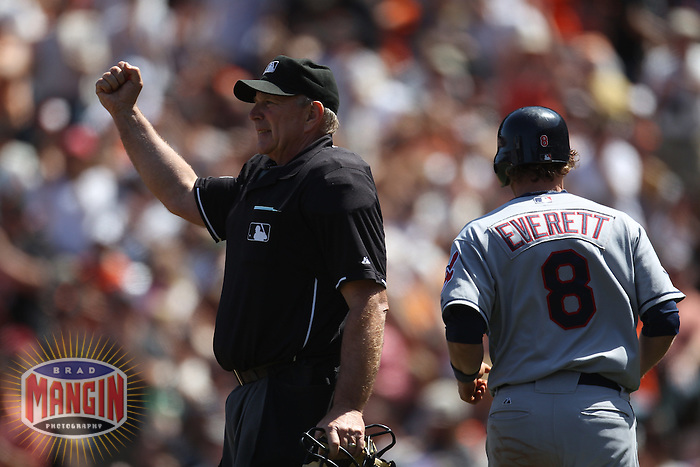 SAN FRANCISCO - JUNE 25:  Home plate umpire Bob Davidson calls Cleveland Indians base runner Adam Everett #8 out on the bases during the game between the Cleveland Indians and the San Francisco Giants at AT&T Park on June 25, 2011 in San Francisco, California. Photo by Brad Mangin