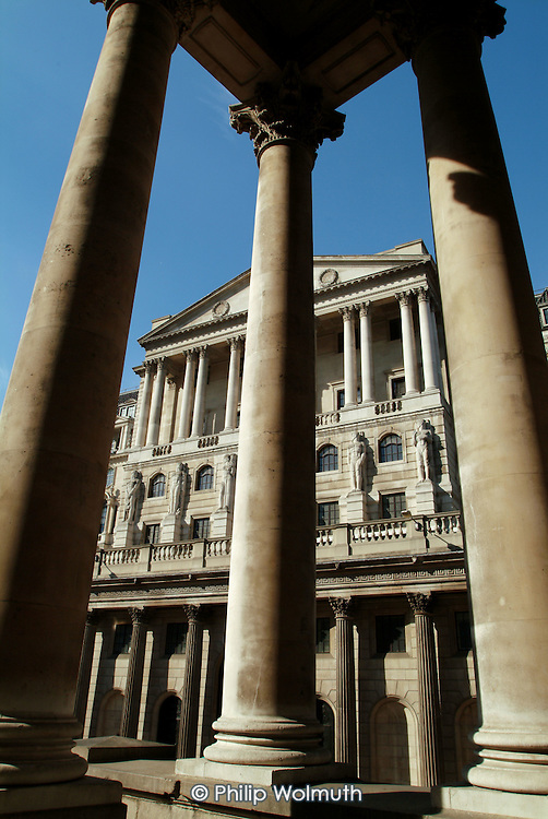 The Bank of England seen through the columns of the Royal Exchange, City of London.