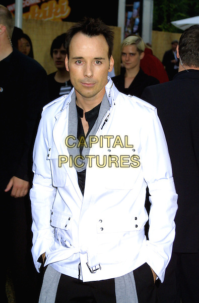 DAVID FURNISH.Serpentine Gallery Summer Party 2003, Hyde Park.www.capitalpictures.com.sales@capitalpictures.com.© Capital Pictures.hands in pockets, white jacket