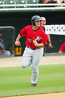 Brent Tanner (43) of the Kannapolis Intimidators watches for the baseball as he heads towards home plate to score a run against the Lexington Legends at CMC-Northeast Stadium on July 31, 2013 in Kannapolis, North Carolina.  The Intimidators defeated the Legends 3-2.  (Brian Westerholt/Four Seam Images)