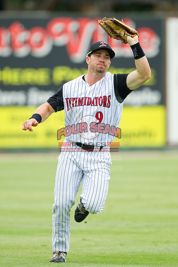 Kannapolis Intimidators left fielder Kale Kiser (9) chases down a fly ball against the Greenville Drive at CMC-Northeast Stadium on June 30, 2013 in Kannapolis, North Carolina.  The Drive defeated the Intimidators 3-0.   (Brian Westerholt/Four Seam Images)