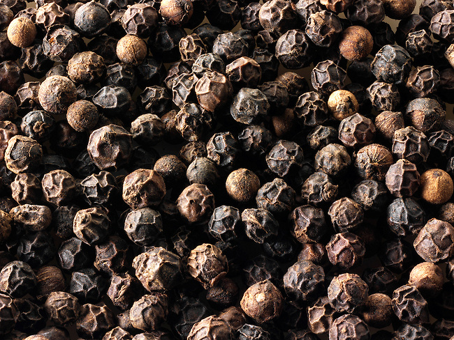 Black pepper corns stock photos