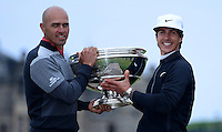 Thorbjorn Olesen of Denmark poses with playing partner Kelly Slater (L) and the trophy on the Swilcan Bridge following his victory during the Final Round of the 2015 Alfred Dunhill Links Championship at the Old Course, St Andrews, in Fife, Scotland on 4/10/15.<br /> Picture: Richard Martin-Roberts | Golffile