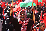 A Palestinian supporter of the Democratic Front for the Liberation of Palestine (DFLP) carries flag during a rally celebrating 42 years since its founding in Gaza City, Saturday, Feb. 26, 2011. Founded in 1969 the DFLP is a Palestinian Marxist-Leninist, secular political and military organization. Photo by Ashraf Amra