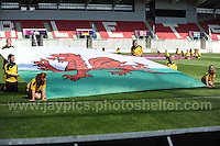 The ballgirls unveil the Welsh national flag before the game begins. The UEFA Womens U19 Championships at Parc y Scarlets, Monday 19th August 2013. All images are the copyright of Jeff Thomas Photography-www.jaypics.photoshelter.com-07837 386244-Any use of images must be authorised by the copyright owner.