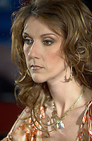 April 03, 2002, Montreal, Quebec, Canada; <br /> <br /> Singer Celine Dion talk about her new ballad-heavy album, A New Day Has Come after her two-year break,  during a press conference, with Rene Angelil, her husband and manager, April 03, 2002, in Montreal, Canada.<br /> <br /> Her new album is at the number one in 18 countries<br /> <br /> Her husband Rene Angelil finds himself fending off a civil suit alleging assault and sexual battery, that apparently happened two years ago in Las Vegas.<br /> <br /> Photo by (c) 2002, Pierre Roussel / Images Distribution<br /> <br /> NOTE :  D-1  original JPEG, saved as Adobe 1998 RGB