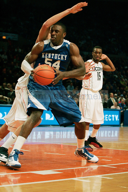 Senior forward Patrick Patterson tries to take a shot in the first half of UK's game against UCONN at Madison Square Gardens in New York, NY. Photo by Britney McIntosh | Staff