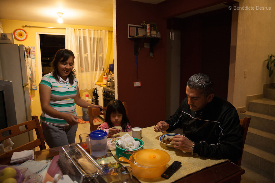 "Donovan eats dinner with his wife and daughter in Texcoco, Mexico on February 1, 2016. Donovan Tavera, 43, is the director of ""Limpieza Forense México"", the country's first and so far the only government-accredited forensic cleaning company. Since 2000, Tavera, a self-taught forensic technician, and his family have offered services to clean up homicides, unattended death, suicides, the homes of compulsive hoarders and houses destroyed by fire or flooding. Despite rising violence that has left 70,000 people dead and 23,000 disappeared since 2006, Mexico has only one certified forensic cleaner. As a consequence, the biological hazards associated with crime scenes are going unchecked all around the country. Photo by Bénédicte Desrus"