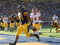 Khalfani Muhammad of California scores a touchdown during NCAA football game against USC at Memorial Stadium in Berkeley, California on November 9th, 2013.   USC defeated California, 62-28.