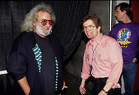 "Jerry Garcia of The Grateful Dead talks backstage with band publicist Dennis McNally before a concert in Oakland. The remaining members of the band will reunite for the final time for the ""Fare Thee Well"" concerts  over July 4th weekend in 2015."