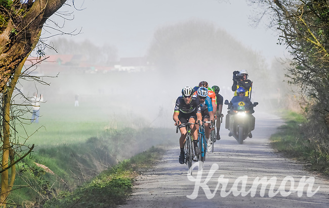 breakaway group led by Jay Robert Thomson (ZAF/Dimension Data) over the gravel of the 'Plugstreets'<br /> <br /> 79th Gent-Wevelgem 2017 (1.UWT)<br /> 1day race: Deinze › Wevelgem - BEL (249km)