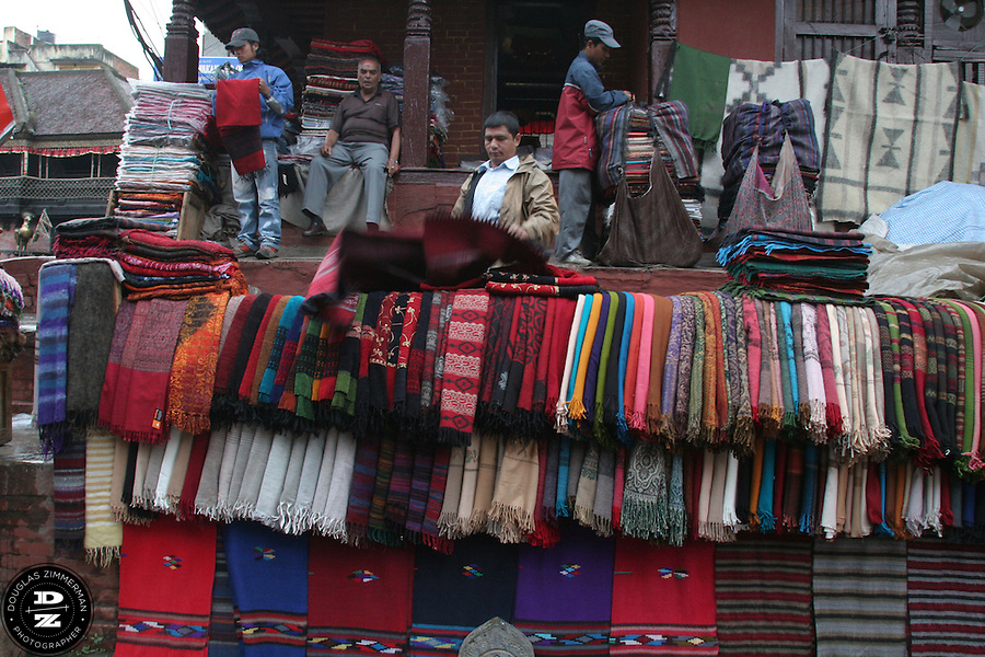 Vendors display their textiles on the streets of old-town Kathmandu, just outside the city's Durbar Square.  Photograph by Douglas ZImmerman